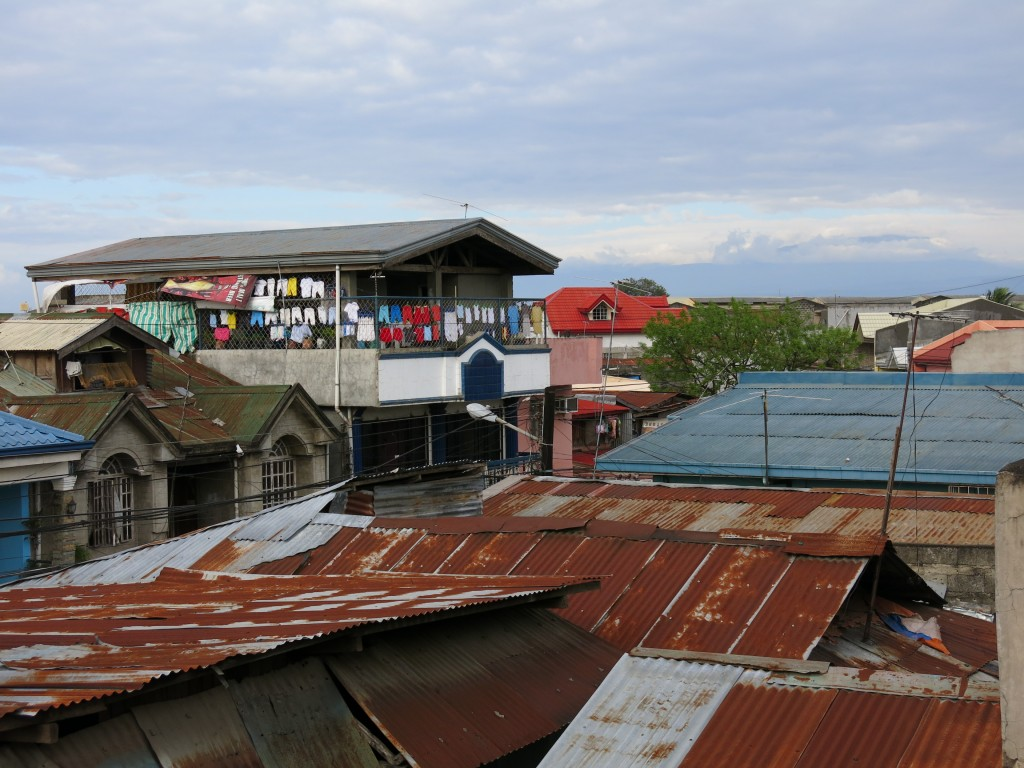 The rooftops of our couch surfing host's neighborhood in Cagayan de Oro. Photo by Naomi Krueger.