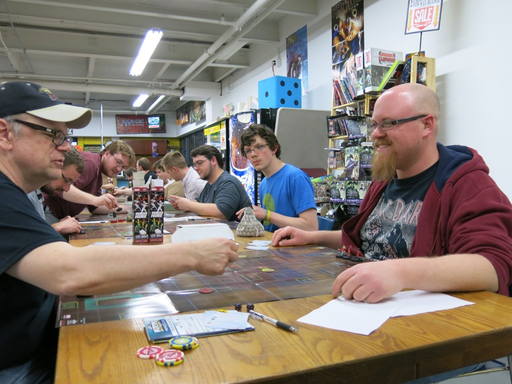 Guys playing Hero Clix, with Marvel and DC Comics characters, at Source Comics and Games. Photo by Naomi Krueger